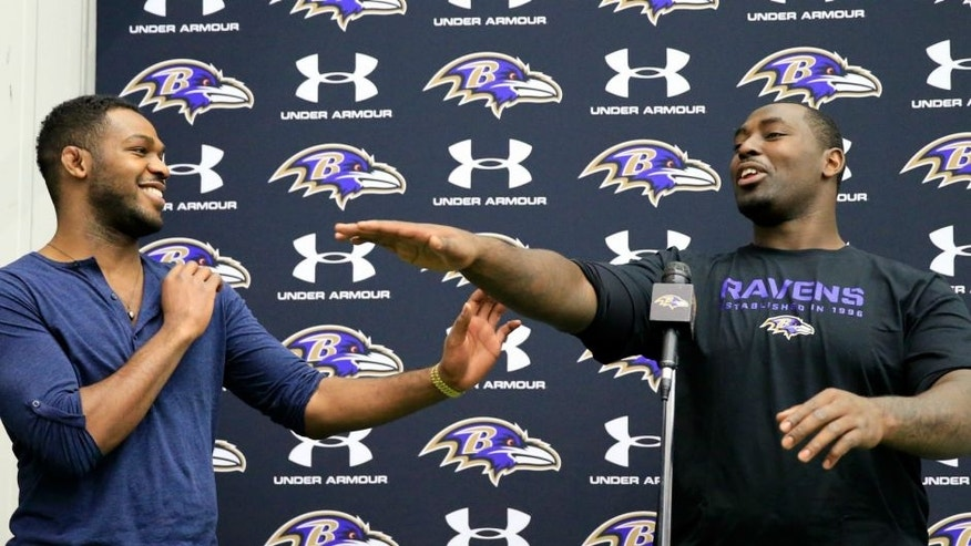 on November 13, 2013 in Owings Mills, Maryland.,OWINGS MILLS, MD - NOVEMBER 13: UFC fighter Jon Jones (L) jokes around with his brother defensive end Arthur Jones #97 of the Baltimore Ravens during a news conference at the teams training facility November 13, 2013 in Owings Mills, Maryland. (Photo by Rob Carr/Getty Images)