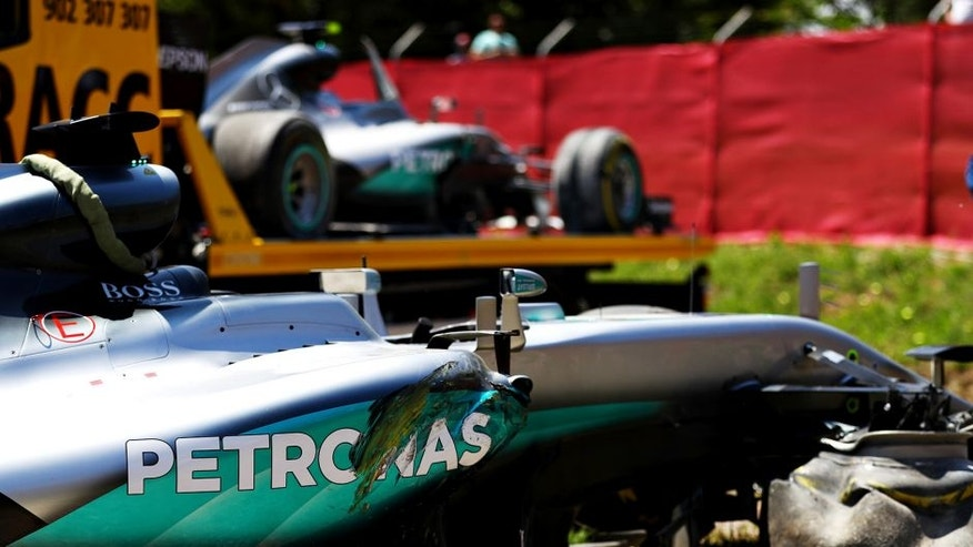 MONTMELO, SPAIN - MAY 15: The car of Lewis Hamilton of Great Britain and Mercedes GP at the side of the track, behind is the car of Nico Rosberg of Germany and Mercedes GP after they crashed together during the Spanish Formula One Grand Prix at Circuit de Catalunya on May 15, 2016 in Montmelo, Spain. (Photo by Clive Mason/Getty Images)