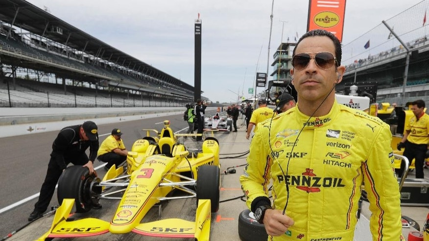 Helio Castroneves, of Brazil, watches before a practice session for the Indianapolis 500 auto race at Indianapolis Motor Speedway in Indianapolis, Monday, May 16, 2016. (AP Photo/Darron Cummings)