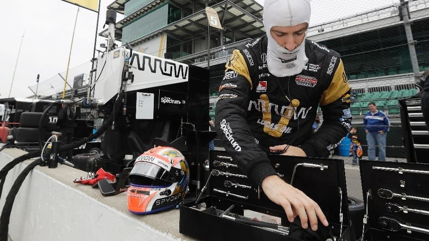 James Hinchcliffe, of Canada, looks in a toolbox during a practice session for the Indianapolis 500 auto race at Indianapolis Motor Speedway in Indianapolis, Monday, May 16, 2016. (AP Photo/Darron Cummings)