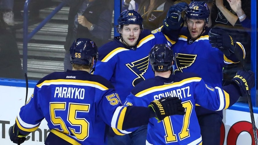 May 15, 2016; St. Louis, MO, USA; St. Louis Blues center Jori Lehtera (12) is congratulated by right wing Vladimir Tarasenko (91) and left wing Jaden Schwartz (17) and defenseman Colton Parayko (55) after scoring a goal against San Jose Sharks goalie Martin Jones (not pictured) during the second period in game one of the Western Conference Final of the 2016 Stanley Cup Playoffs at Scottrade Center. Mandatory Credit: Billy Hurst-USA TODAY Sports