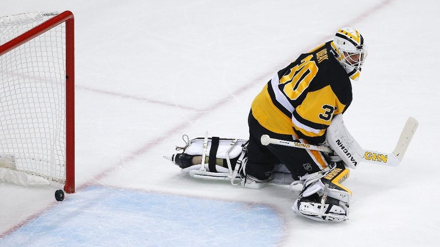 A shot by Tampa Bay Lightning's Jonathan Drouin gets past Pittsburgh Penguins goalie Matt Murray (30) for a goal during the first period of Game 2 of the NHL hockey Stanley Cup Eastern Conference finals Monday, May 16, 2016 in Pittsburgh. (AP Photo/Gene J. Puskar)