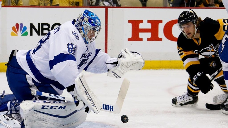 Tampa Bay Lightning goalie Andrei Vasilevskiy makes a save as Pittsburgh Penguins' Carl Hagelin, right, skates to the net during the first period of Game 2 of the NHL hockey Stanley Cup Eastern Conference finals, Monday, May 16, 2016, in Pittsburgh. (AP Photo/Gene J. Puskar)