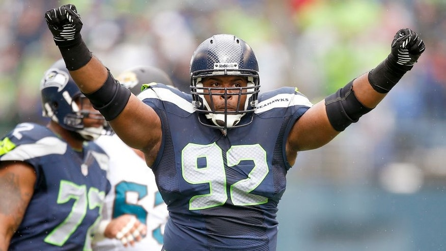 SEATTLE, WA - SEPTEMBER 22: Defensive tackle Brandon Mebane #92 of the Seattle Seahawks celebrates a tackle in the first half against the Jacksonville Jaguars at CenturyLink Field on September 22, 2013 in Seattle, Washington. (Photo by Otto Greule Jr/Getty Images)