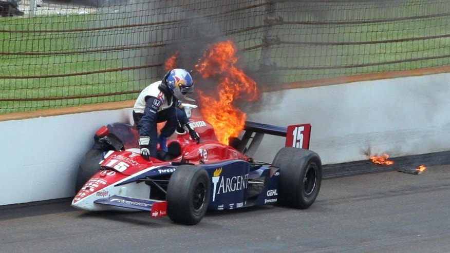 FILE - In this May 28, 2006, file photo, Buddy Rice climbs from his burning car after a crash during the 90th running of the Indianapolis 500 auto race at the Indianapolis Motor Speedway in Indianapolis. (AP Photo/Don Larson, File)