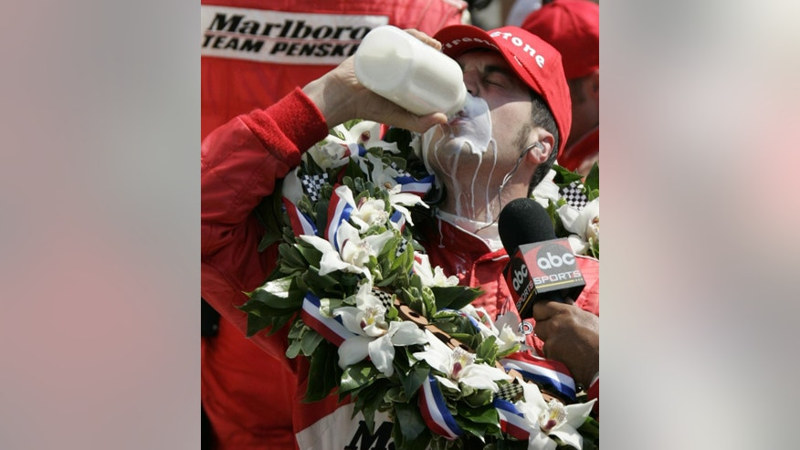 FILE - In this May 28, 2006, file photo, Sam Hornish Jr. drinks from a bottle of milk after his victory in the 90th running of the Indianapolis 500 auto race at the Indianapolis Motor Speedway, in Indianapolis. (AP Photo/Darron Cummings, File)