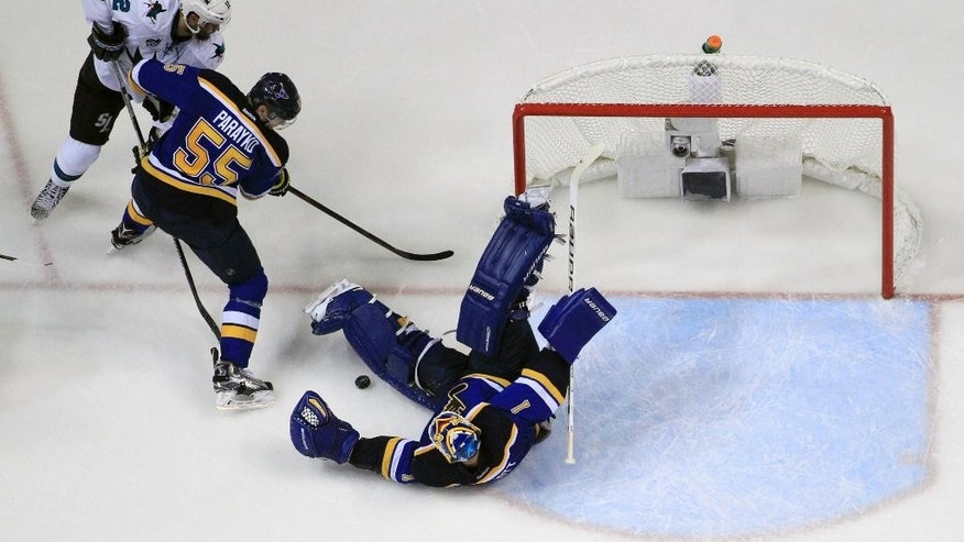 May 15, 2016: St. Louis Blues goalie Brian Elliott (1) makes the save as San Jose Sharks center Patrick Marleau (12) and the Blues defenseman Colton Parayko (55) battle for the puck during the third period in Game 1 of the NHL Western Conference finals in St. Louis