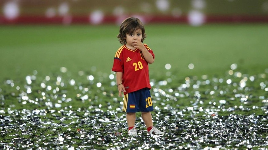 Football - Spain v Italy - UEFA EURO 2012 Final - Olympic Stadium, Kiev, Ukraine - 1/7/12 Spain's Santi Cazorla's son celebrates after the match Mandatory Credit: Action Images / Carl Recine Livepic
