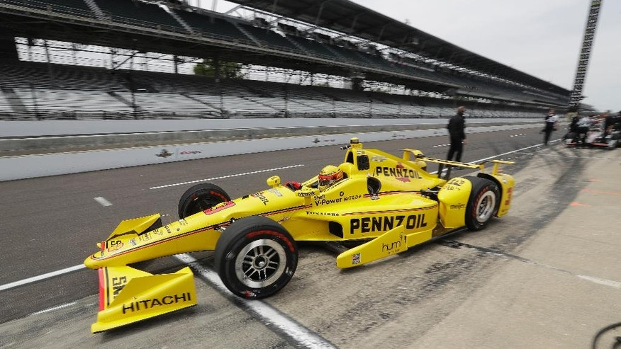 Helio Castroneves, of Brazil, pulls out of the pits during a practice session for the Indianapolis 500 auto race at Indianapolis Motor Speedway in Indianapolis, Monday, May 16, 2016. (AP Photo/Darron Cummings)