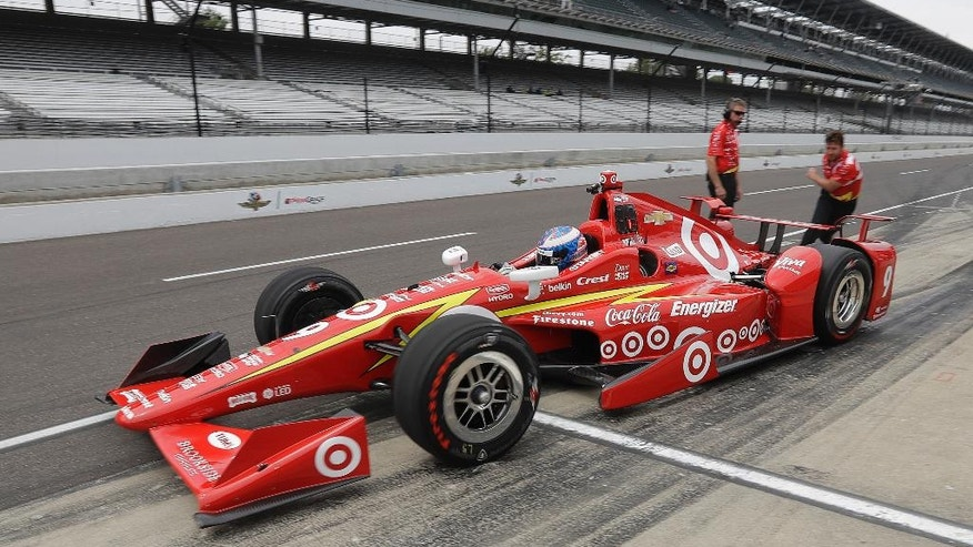Scott Dixon, of New Zealand, pulls out of the pits during a practice session for the Indianapolis 500 auto race at Indianapolis Motor Speedway in Indianapolis, Monday, May 16, 2016. (AP Photo/Darron Cummings)