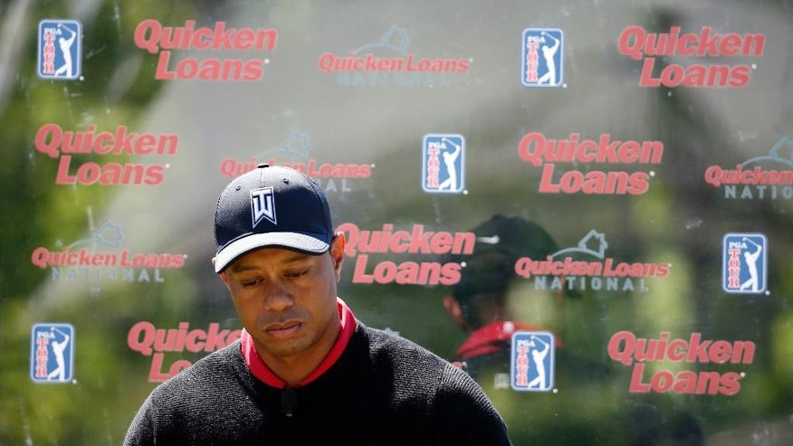 Tiger Woods pauses during a Quicken Loans National golf tournament media availability on the 10th tee at Congressional Country Club, Monday, May 16, 2016 in Bethesda, Md. (AP Photo/Alex Brandon)