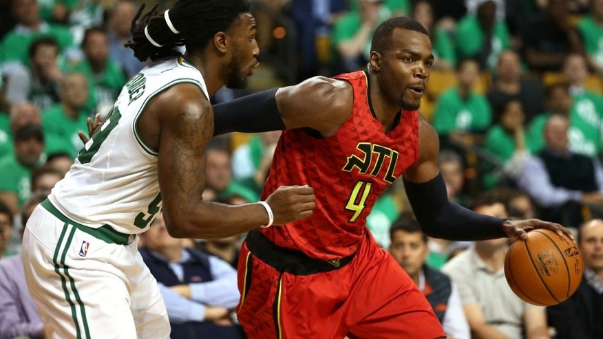Apr 28, 2016; Boston, MA, USA; Atlanta Hawks forward Paul Millsap (4) drives to the hoop against Boston Celtics forward Jae Crowder (left) during the second half in game six of the first round of the NBA Playoffs at TD Garden. Mandatory Credit: Mark L. Baer-USA TODAY Sports