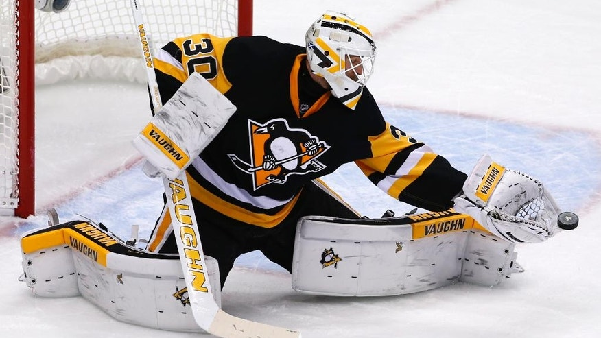 Pittsburgh Penguins goalie Matt Murray gets his glove on a shot during the third period of Game 2 of the NHL hockey Stanley Cup Eastern Conference finals against the Tampa Bay Lightning, Monday, May 16, 2016 in Pittsburgh. (AP Photo/Gene J. Puskar)