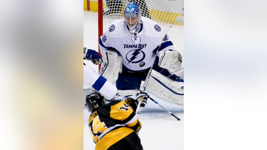 Pittsburgh Penguins' Chris Kunitz (14) shoots on Tampa Bay Lightning goalie Andrei Vasilevskiy during the third period of Game 2 of the NHL hockey Stanley Cup Eastern Conference finals. Monday, May 16, 2016, in Pittsburgh. (AP Photo/Gene J. Puskar)