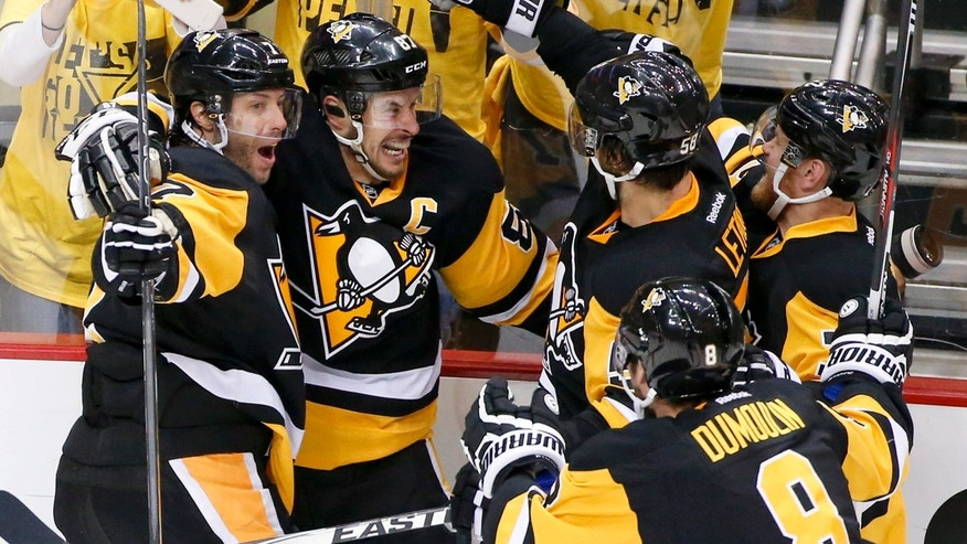 May 16, 2016: Pittsburgh Penguins' Sidney Crosby, second from left, celebrates with teammates Matt Cullen (7), Brian Dumoulin (8), Kris Letang (58) and Patric Hornqvist. right, after scoring the game-winning goal in overtime of Game 2 of the Eastern Conference final against the Tampa Bay Lightning.