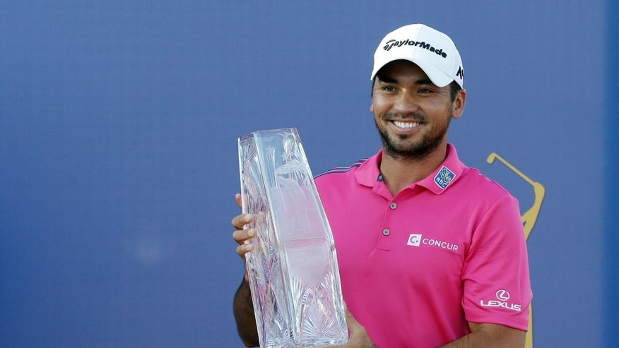 Jason Day of Australia, holds The Players Championship trophy Sunday, May 15, 2016, in Ponte Vedra Beach, Fla. (AP Photo/Lynne Sladky)