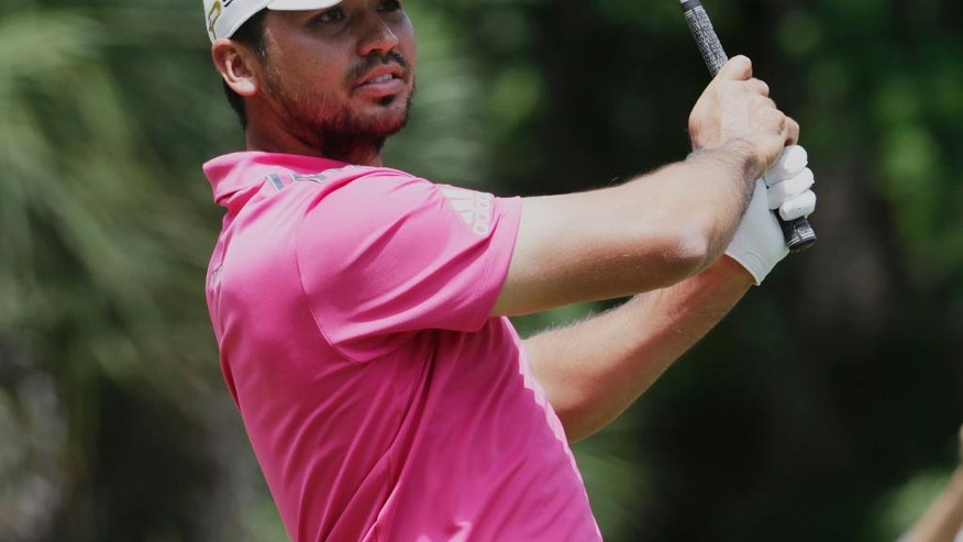 Jason Day of Australia, keeps an eye on his ball from the second tee during the final round of The Players Championship golf tournament Sunday, May 15, 2016, in Ponte Vedra Beach, Fla. (AP Photo/Lynne Sladky)