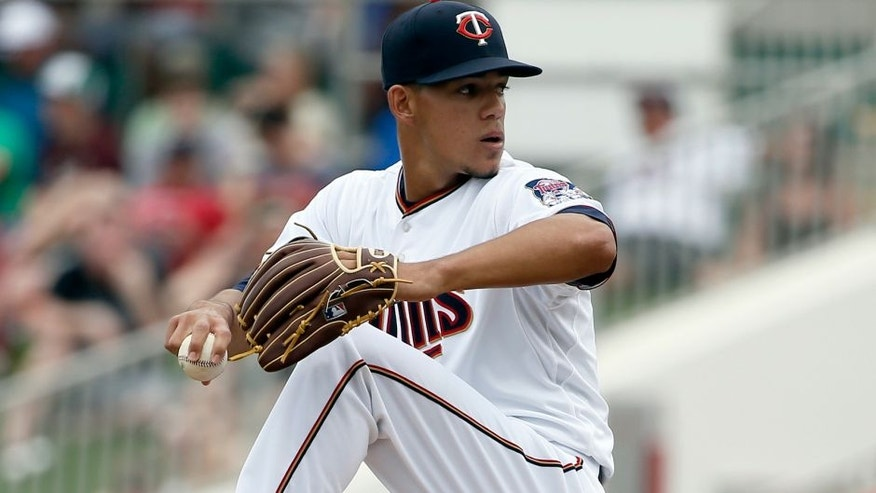 <p>Minnesota Twins' Jose Berrios winds up to deliver to the Baltimore Orioles in the third inning of a spring training baseball game in Fort Myers, Fla., Sunday March 8, 2015. (AP Photo/Tony Gutierrez)</p>