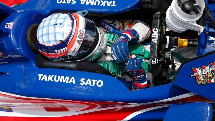 Takuma Sato, of Japan, sits in his car during a break in a practice session for the Indianapolis 500 auto race at Indianapolis Motor Speedway in Indianapolis, Wednesday, May 18, 2016. (AP Photo/Michael Conroy)