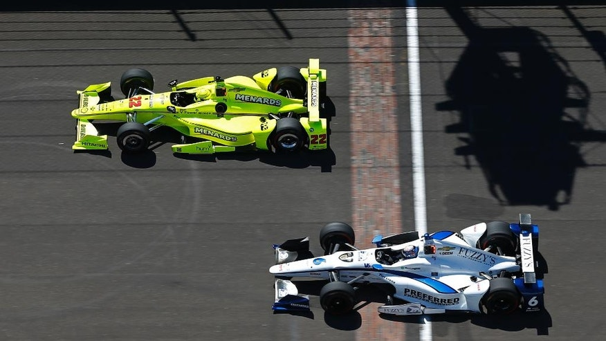 Simon Pagenaud, of France, top, and JR Hildebrand speed down the main straightaway during a practice session for the Indianapolis 500 auto race at Indianapolis Motor Speedway in Indianapolis, Wednesday, May 18, 2016. (AP Photo/Michael Conroy)