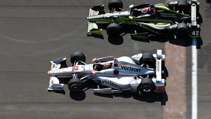 Will Power, of Australia, bottom, and Charlie Kimball speed down the main straightaway during a practice session for the Indianapolis 500 auto race at Indianapolis Motor Speedway in Indianapolis, Wednesday, May 18, 2016. (AP Photo/Michael Conroy)