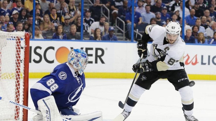 Tampa Bay Lightning goalie Andrei Vasilevskiy (88), of Russia, deflects a shot by Pittsburgh Penguins center Sidney Crosby (87) during the third period of Game 3 of the NHL hockey Stanley Cup Eastern Conference finals Wednesday, May 18, 2016, in Tampa, Fla. The Penguins defeated the Lightning 4-2. (AP Photo/Chris O'Meara)