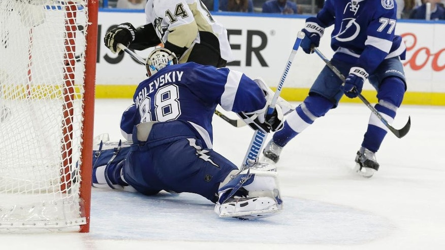 Pittsburgh Penguins left wing Chris Kunitz (14) scores a goal against Tampa Bay Lightning goalie Andrei Vasilevskiy (88), of Russia, during the third period of Game 3 of the NHL hockey Stanley Cup Eastern Conference Finals Wednesday, May 18, 2016, in Tampa, Fla. Lightning defenseman Victor Hedman, of Sweden, is at right. (AP Photo/Chris O'Meara)