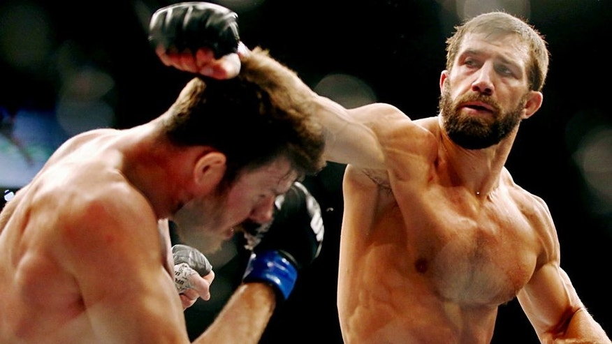 SYDNEY, AUSTRALIA - NOVEMBER 08: Michael Bisping of England ducks a punch from Luke Rockhold of the USA in their middleweight fight during the UFC Fight Night 55 event at Allphones Arena on November 8, 2014 in Sydney, Australia. (Photo by Mark Kolbe/Getty Images)