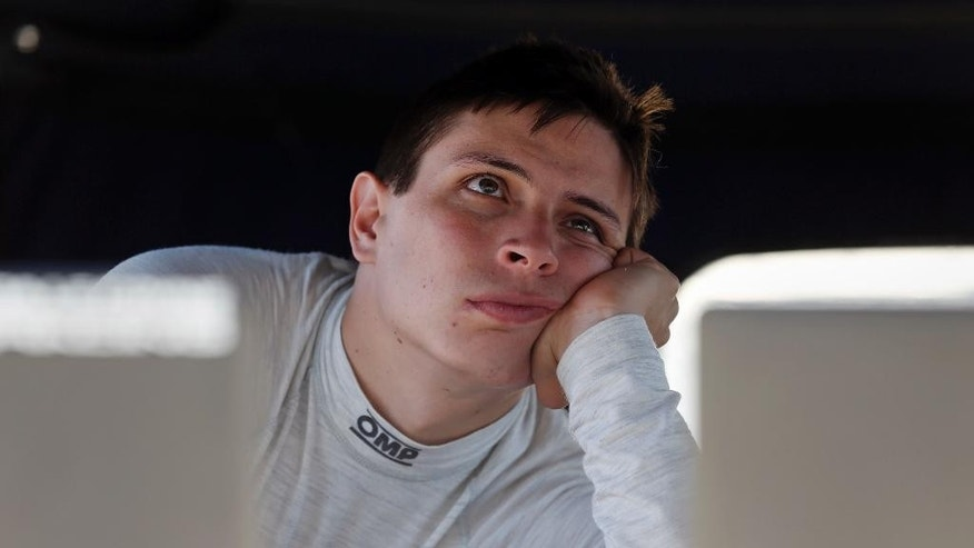 Gabby Chaves, of Colombia, watches the action on a monitor in the pit area during a practice session for the Indianapolis 500 auto race at Indianapolis Motor Speedway in Indianapolis, Thursday, May 19, 2016. (AP Photo/Michael Conroy)