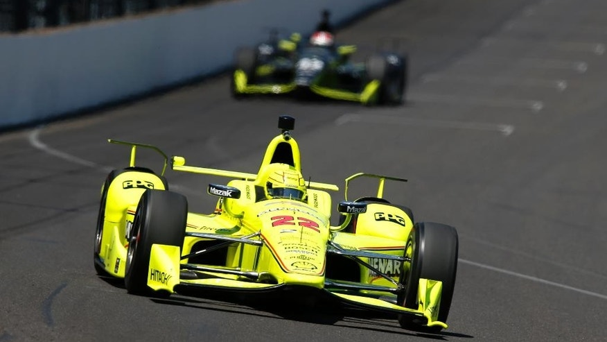Simon Pagenaud, of France, heads into the first turn during a practice session for the Indianapolis 500 auto race at Indianapolis Motor Speedway in Indianapolis, Thursday, May 19, 2016. (AP Photo/Michael Conroy)