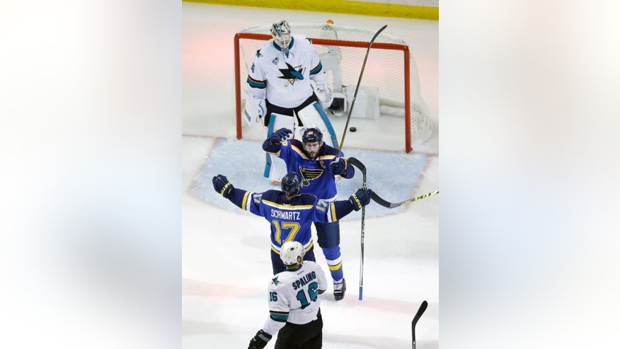 St. Louis Blues center David Backes (42) celebrates with left wing Jaden Schwartz (17) after scoring a goal against San Jose Sharks goalie Martin Jones (31) during the first period in Game 1 of the NHL hockey Stanley Cup Western Conference finals, Sunday, May 15, 2016, in St. Louis. (AP Photo/Jeff Roberson)