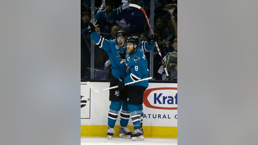 San Jose Sharks' Tomas Hertl (48) celebrates his goal with teammate Joe Pavelski (8) during the first period in Game 3 of the NHL hockey Stanley Cup Western Conference finals against the St. Louis Blues Thursday, May 19, 2016, in San Jose, Calif. (AP Photo/Marcio Jose Sanchez)