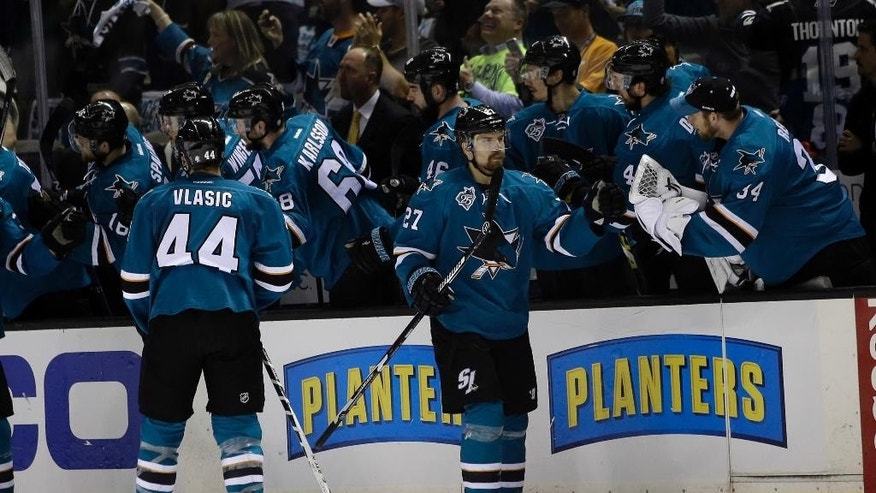 San Jose Sharks' Joonas Donskoi (27) celebrates with teammates after scoring against the St. Louis Blues during the second period in Game 3 of the NHL hockey Stanley Cup Western Conference finals Thursday, May 19, 2016, in San Jose, Calif. (AP Photo/Marcio Jose Sanchez)