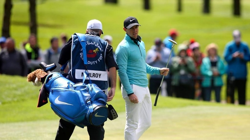Northern Ireland's Rory McIlroy with his caddy J.P. Fitzgerald on the fourth green during day one of the Irish Open golf tournament at The K Club, Straffran, County Kildare, Ireland, Thursday May 19, 2016. Tournament host Rory McIlroy, who started later in milder afternoon conditions at Ireland's K Club resort, is seeking his first season victory. But the Northern Ireland native and world's No. 3-ranked player has rarely fared well at his home tournament, missing the cut for the past three years. (Brian Lawless/PA via AP)  UNITED KINGDOM OUT