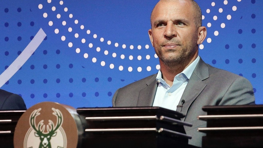 Milwaukee Bucks head coach Jason Kidd listens as the results of the NBA basketball draft lottery are announced, Tuesday, May 17, 2016, in New York.