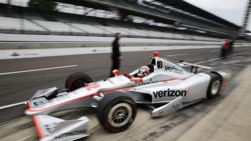 Will Power, of Australia, drives out of the pit area during a practice session for the Indianapolis 500 auto race at Indianapolis Motor Speedway in Indianapolis, Friday, May 20, 2016. (AP Photo/Michael Conroy)