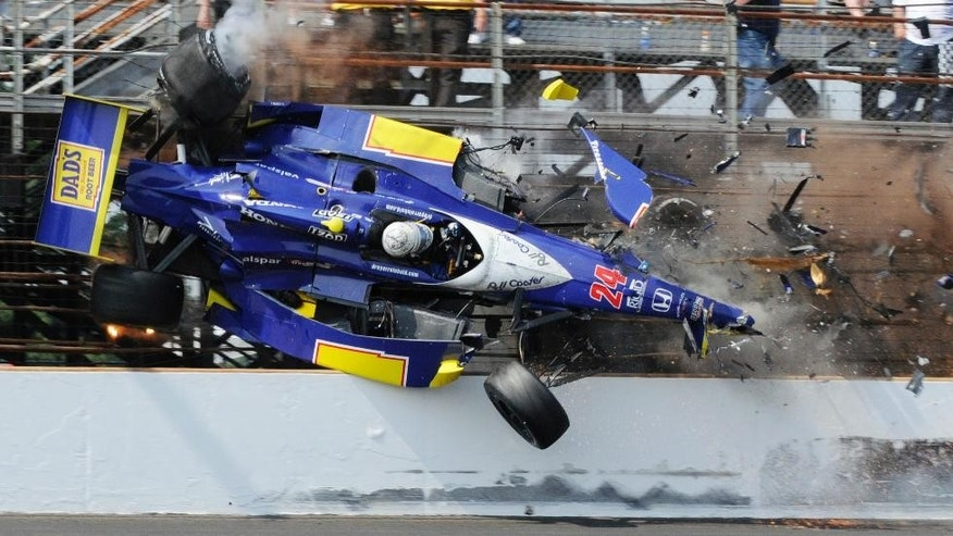 FILE - In this May 30, 2010, file photo, Mike Conway, of England, crashes in the third turn in the closing laps of the Indianapolis 500 auto race at Indianapolis Motor Speedway in Indianapolis. (AP Photo/James Miller, FIle)
