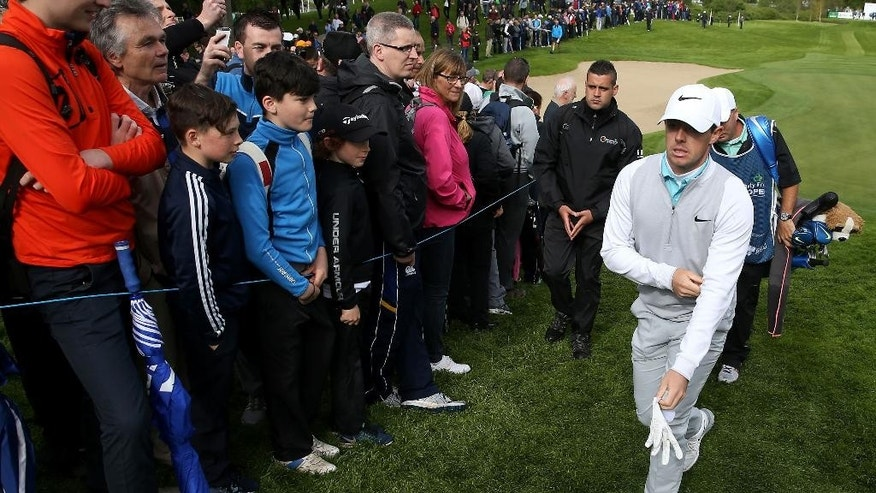 Crowds gather as Northern Ireland's Rory McIlroy makes his way to the 14th tee, during day two of the Irish Open golf tournament at The K Club, County Kildare, Ireland,  Friday May 20, 2016. (Brian Lawless / PA via AP) UNITED KINGDOM OUT - NO SALES - NO ARCHIVES