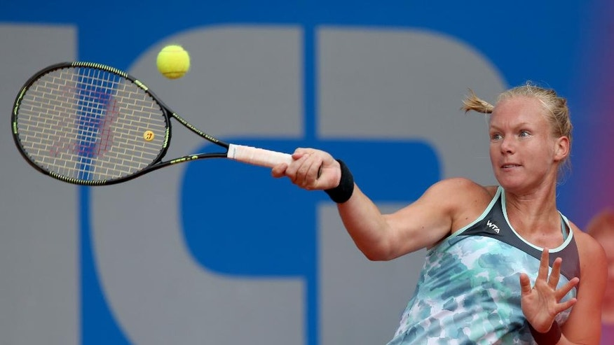Kiki Bertens of the Netherlands returns the ball to Germany's Julia Goerges during their semifinal match at the WTA tennis tournament in Nuremberg, Germany, Friday, May 20, 2016. (Daniel Karmann/dpa via AP)