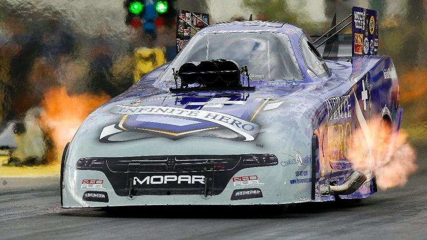 "Funny Car driver ""Fast"" Jack Beckman tears down the track in his funny car during qualifying for the NHRA Kansas Nationals drag races on Friday May 20 2016, at Heartland Park in Topeka, Kan. (Chris Neal/The Topeka Capital-Journal via AP) MANDATORY CREDIT"
