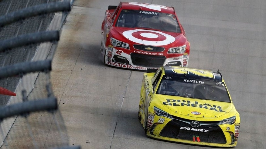 DOVER, DE - MAY 15: Matt Kenseth, driver of the #19 Stanley Toyota, leads Kyle Larson, driver of the #42 Target Chevrolet, during the NASCAR Sprint Cup Series AAA 400 Drive for Autism at Dover International Speedway on May 15, 2016 in Dover, Delaware. (Photo by Patrick Smith/Getty Images)