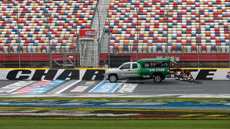 CHARLOTTE, NC - MAY 20: An Air Titan 2.0 truck works to dry the track prior to practice for the NASCAR Sprint Cup Series Sprint Showdown at Charlotte Motor Speedway on May 20, 2016 in Charlotte, North Carolina. (Photo by Brian Lawdermilk/Getty Images)
