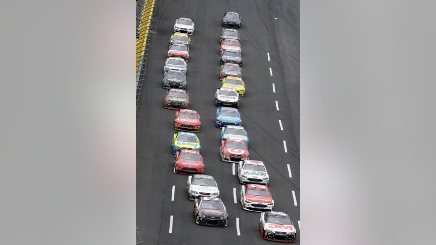 CORRECTS DATE - Cars line up on the front stretch as they approach the start-finish line to begin the NASCAR Sprint Cup Series Showdown auto race at the Charlotte Motor Speedway in Concord, N.C., Saturday, May 21, 2016. (AP Photo/Gerry Broome)
