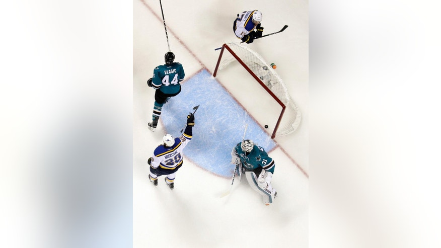 St. Louis Blues' Kyle Brodziak, bottom left, celebrates after scoring past San Jose Sharks goalie Martin Jones (31) and Marc-Edouard Vlasic (44) during the second period in Game 4 of the NHL hockey Stanley Cup Western Conference finals Saturday, May 21, 2016, in San Jose, Calif. (AP Photo/Marcio Jose Sanchez)
