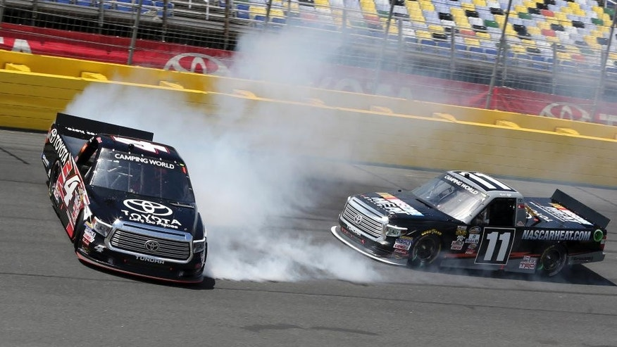Christopher Bell (4) spins in front of Matt Tifft (11) in Turn 4 during the NASCAR Truck series auto race at Charlotte Motor Speedway in Concord, N.C., Saturday, May 21, 2016. (AP Photo/Bob Jordan)