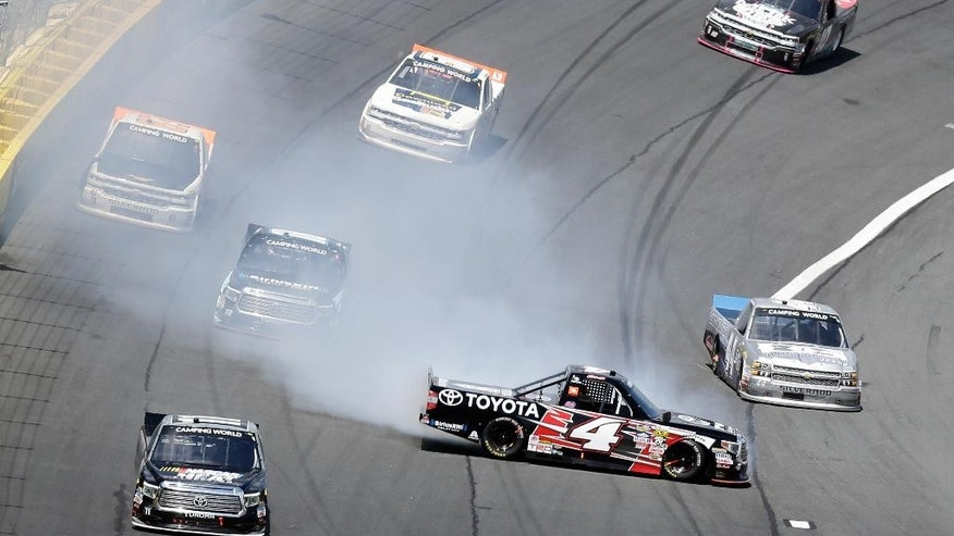 Christopher Bell (4) spins in Turn 4 during the NASCAR Truck Series North Carolina Education Lottery 200 auto race at the Charlotte Motor Speedway in Concord, N.C., Saturday, May 21, 2016. (AP Photo/Gerry Broome)