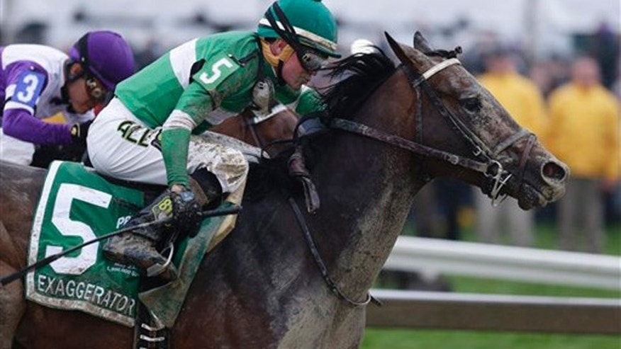Exaggerator with Kent Desormeaux aboard moves past Nyquist with Mario Gutierrez during the 141st Preakness Stakes horse race at Pimlico Race Course, Saturday, May 21, 2016, in Baltimore. Exaggerator won the race. (AP Photo/Garry Jones)