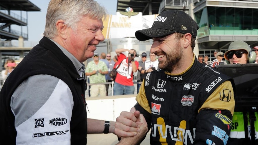 James Hinchcliffe, right, of Canada, celebrates with a crew member after he qualified on the opening day of qualifications for the Indianapolis 500 auto race at Indianapolis Motor Speedway in Indianapolis, Saturday, May 21, 2016. (AP Photo/Darron Cummings)