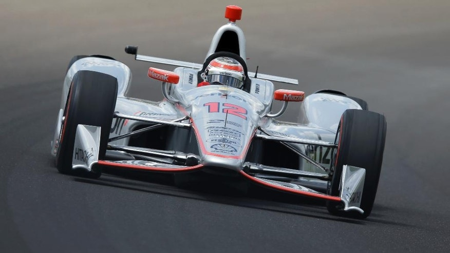 Will Power, of Australia, drives the the first turn during a practice session on the opening day of qualifications for the Indianapolis 500 auto race at Indianapolis Motor Speedway in Indianapolis, Saturday, May 21, 2016. (AP Photo/Michael Conroy)