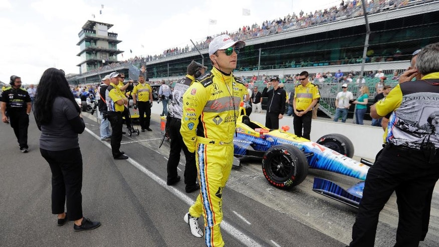 Townsend Bell walks with his car through the line to qualify on the opening day of qualifications for the Indianapolis 500 auto race at Indianapolis Motor Speedway in Indianapolis, Saturday, May 21, 2016. (AP Photo/Darron Cummings)